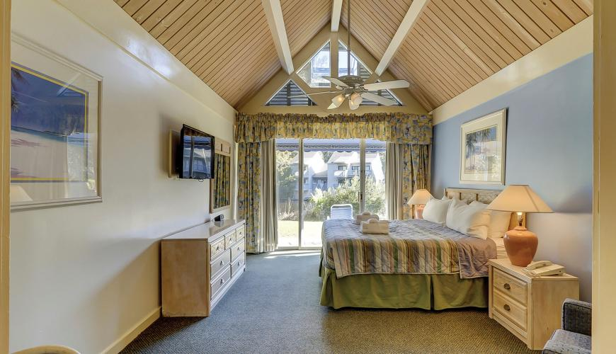 Master Bedroom with Vaulted Ceilings and Private Patio