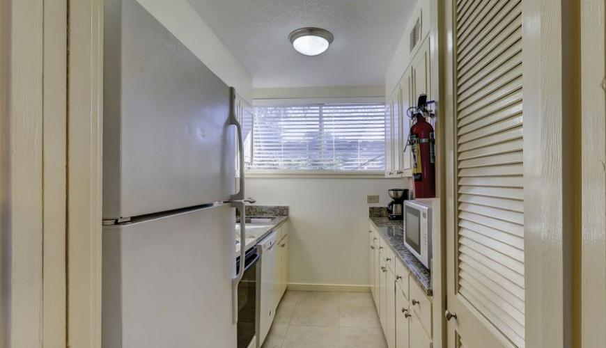 Galley Style Kitchen With Granite Countertops