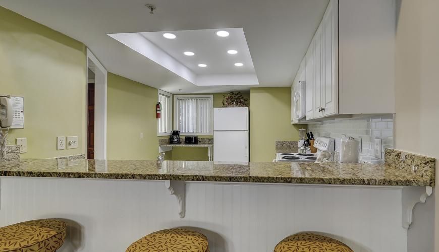 Breakfast bar area open to kitchen