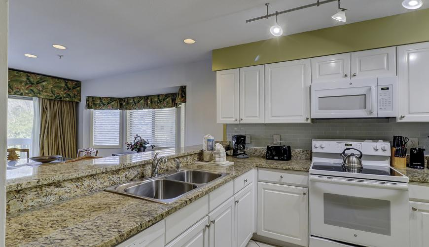 Well appointed kitchen with granite countertops