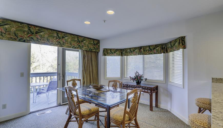 Dining area with bay window and patio glass sliding doors