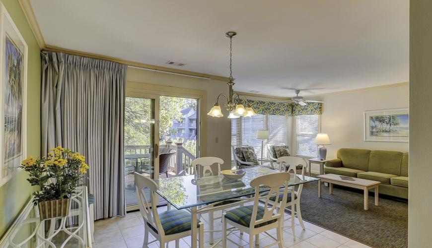 Dining Room Area With Patio Glass Doors To Deck